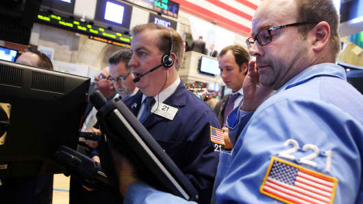 Traders work on the floor of the New York Stock Exchange during early trading on December 16, 2013 in New York City.