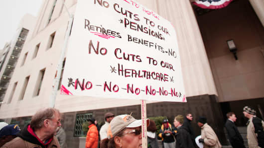 Protestors rally in front of the U.S. Courthouse in Detroit, October 28, 2013.