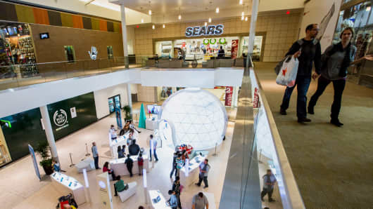 Shoppers inside the Roseville Galleria mall in Roseville, California, U.S., on Saturday, Dec. 14, 2013.