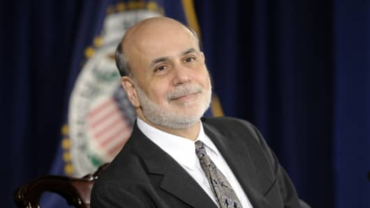 Federal Reserve Chairman Ben Bernanke smiles as he is asked a question during a news conference at the Federal Reserve in Washington, Wednesday, Dec. 18, 2013.