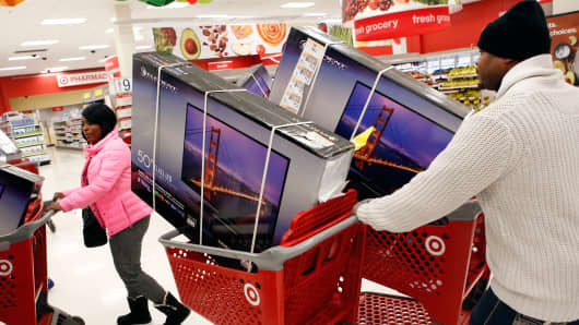 Shoppers purchase TVs at a Target store during the Black Friday weekend in Chicago.