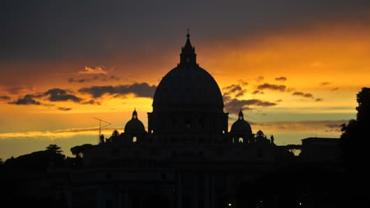 Sunset over St Peter's basilica at the Vatican, Rome