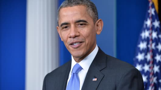 President Barack Obama gives a press conference in the Brady Briefing Room at the White House in Washington on December 20, 2013.