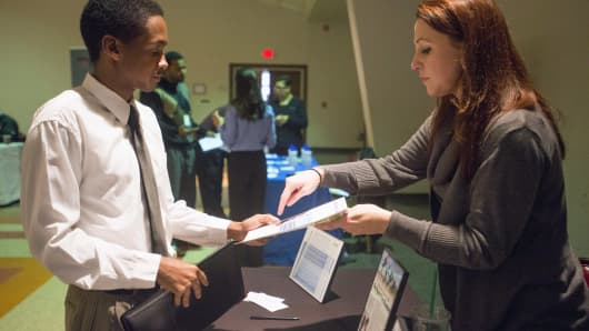 A recruiter, right, meets with a job seeker at the Columbus Career Fair in Columbus, Ohio.