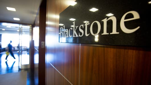 The Blackstone Group LP logo hangs in the company's offices in New York.