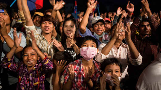 Cambodia National Rescue Party supporters cheer at Freedom Park on December 29, 2013 in Phnom Penh, Cambodia.