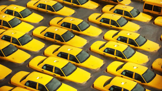 Taxis sit in a flooded lot after Hurricane Sandy on October 30, 2012, in Hoboken, N.J.