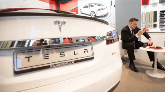 Elon Musk with a Tesla Model S