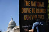 A worker set up a sign for a news conference held by Mayors Against Illegal Guns September 19, 2013 on Capitol Hill in Washington, DC.