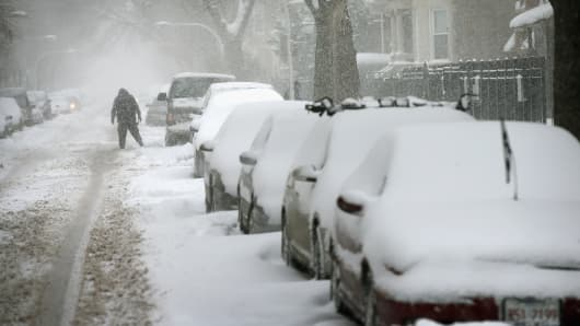 Snow covers cars in the Humboldt Park neighborhood in Chicago, Illinois.