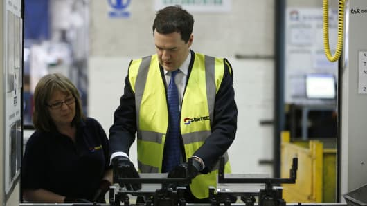 U.K. chancellor of the exchequer, George Osborne, at a Sertec Group Holdings Ltd. factory