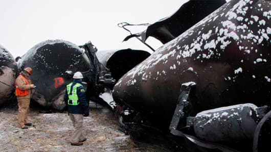 National Transportation Safety Board members views damaged rail cars in Casselton, N.D.