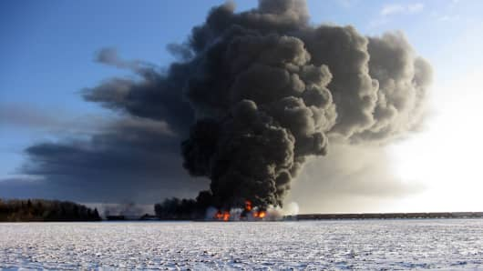 This photo provided by Cass County Commissioner Ken Pawluk shows a train derailment and fire west of Casselton, N.D.
