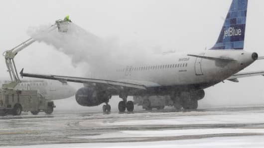 A Jet Blue plane is de-iced during a winter storm in this file photo.