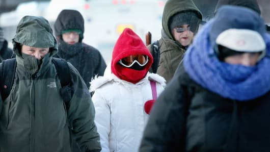 Commuters make a subzero trek to offices in the Loop on Tuesday in Chicago.