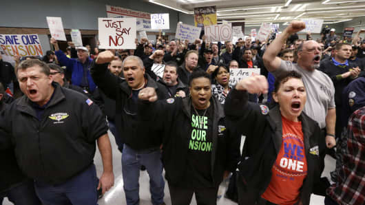 Machinists union members and supporters cheer at a rally asking members to vote against a proposed contract Thursday, Jan. 2, 2014, in Seattle.