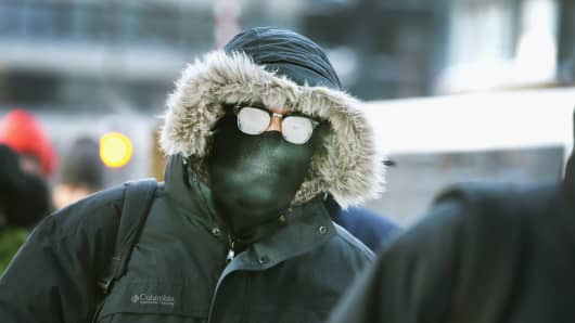 Commuters make a sub-zero trek to offices in the Loop on January 6, 2014 in Chicago, Illinois.