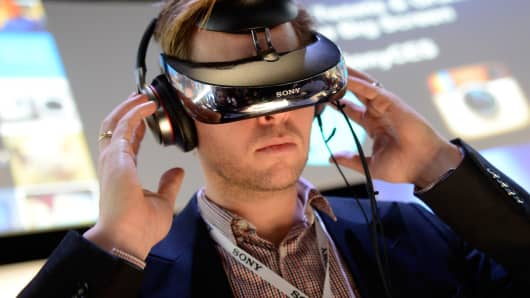 An attendee uses a Sony Head Mounted Display at the Sony booth at the 2014 International CES at the Las Vegas Convention Center on January 7, 2014.