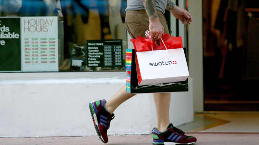 A shopper carries his bags along Lincoln Road Mall in Miami, Beach Florida.