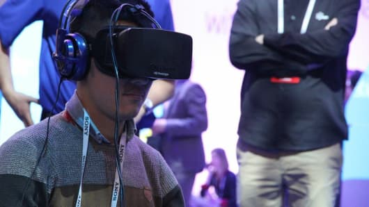 An attendee at CES 2014 test rides some HD glasses.