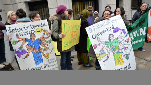 A group supporting domestic workers' rights demonstrate across the street from the Indian Consulate General December 20, 2013 in New York.