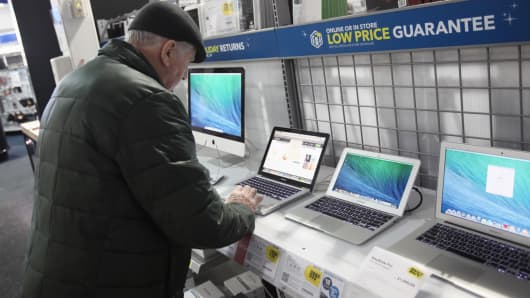 A customer looks at a laptop at a Best Buy Co. store in Northbrook, Illinois, on Monday, Dec. 23, 2013.