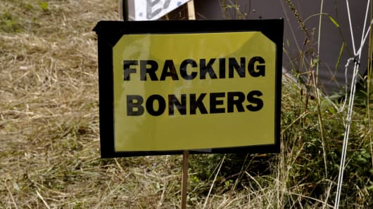 Fracking Bonkers reads a protest sign at the roadside near to a drilling test site in the UK, 2013