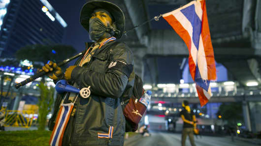 A volunteer security guard in Bangkok bracing for anti-government protests on Monday that could shut down the city.