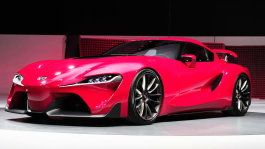 The new Toyota FT-1 Concept is revealed at the press preview of the 2014 North American International Auto Show on Monday in Detroit.
