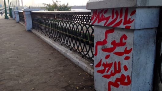 "Graffiti with Egypt's ""Independence Movement"" call to approve new constitution."