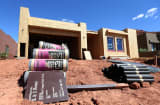 Materials are shown piled outside a single family home under construction in St. George, Utah.