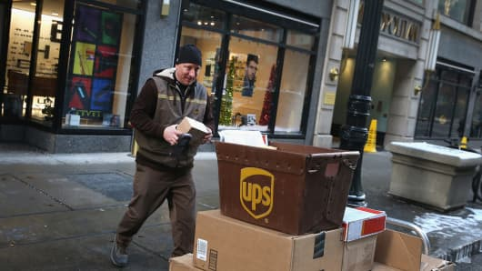 A UPS worker delivers packages in Chicago.