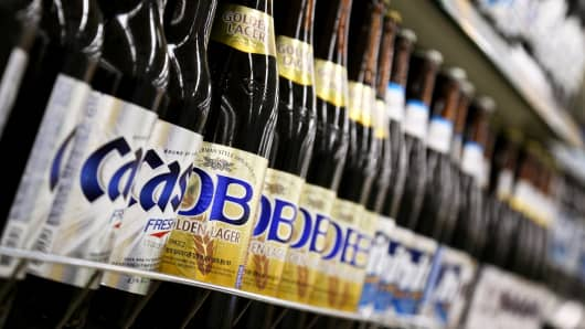 Bottles of Oriental Brewery Co. beer are displayed for sale in Incheon, South Korea, on Saturday, Dec. 21, 2013.