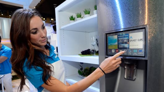 Samsung spokesperson displays the connectivity feature on a Samsung smart refrigerator at the 2014 International CES at the Las Vegas Convention Center.