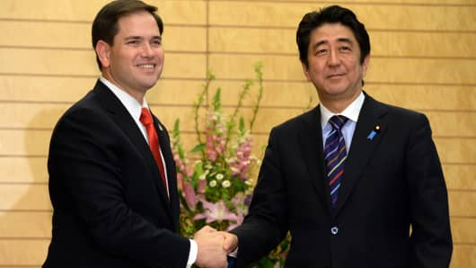 U.S. Senator Marco Rubio (left) shakes hands with Japanese Prime Minister Shinzo Abe (right) prior to their talks at Abe's office in Tokyo on January 21, 2014. Rubio, a member of the U.S. Senate Foreign Relations Committee, is in Japan for talks with Japanese officials.