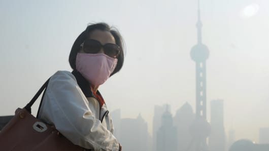 A woman wearing a mask in Shanghai.