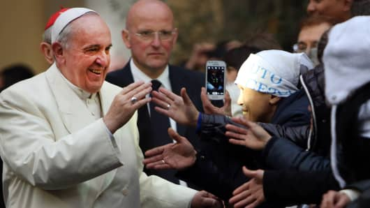 Pope Francis greets faithful as he visits Roman Parish of Sacro Cuore di Gesu' on January 19, 2014 in Rome, Italy.