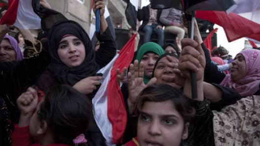 Egyptians celebrate during the constitutional referendum on January 15, 2014 in Cairo, Egypt