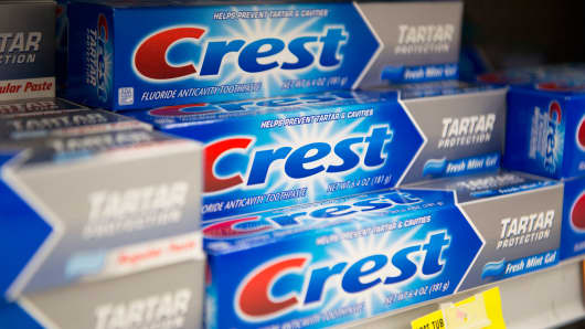 Procter & Gamble Co. Crest brand toothpaste sits on display in a supermarket in Princeton, Illinois, on Wednesday, Oct. 23, 2013.