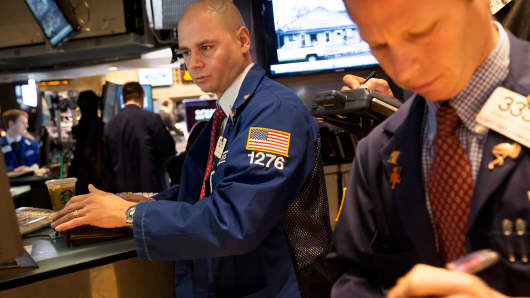 Traders work on the floor of the New York Stock Exchange in New York.
