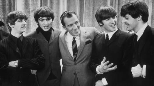 Television host Ed Sullivan with the Beatles on the set of his variety series on Feb. 9, 1964.