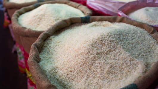 Bags of rice are displayed for sale at a market in Chiang Mai, Thailand.