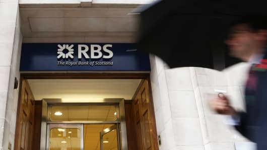 A pedestrian passes a branch of Royal Bank of Scotland Group in London, U.K., on Friday, Nov. 1, 2013.