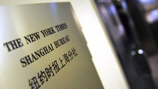 A plaque is seen on the wall outside the New York Times office in Shanghai on October 30, 2012.