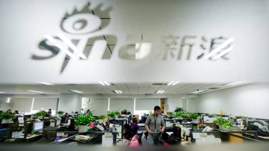 Employees work at Sina Corp.'s headquarters in Beijing, China.