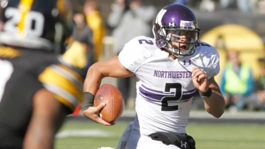 Quarterback Kain Colter of the Northwestern Wildcats in a game against the Iowa Hawkeyes in 2013.