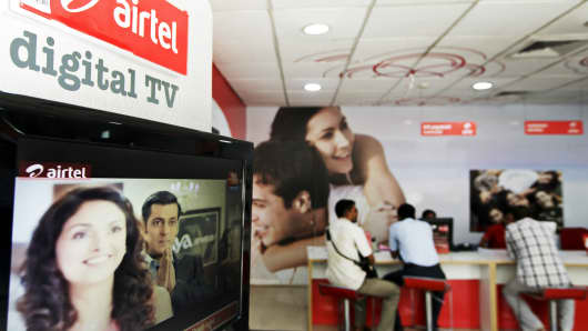 A Bharti Airtel Ltd. digital TV stands on display at the company's flagship store in Mumbai, India on Thursday, May 2, 2013.