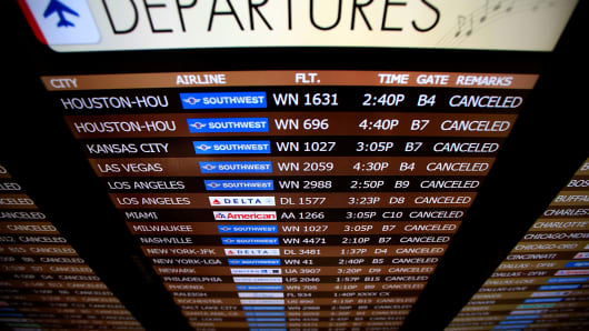 Flights are shown cancelled due to winter weather at Louis Armstrong International Airport on January 28, 2014 in New Orleans, Louisiana. Due to icy condition most businesses and schools have been closed in the metro area.