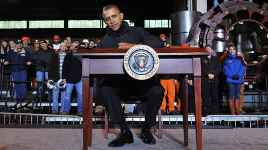 "President Barack Obama signs a memorandum directing the Dept. of the Treasury to create the new ""myRA"" savings program in West Mifflin, Pa., on Jan. 29, 2014."
