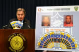 District Attorney Richard Brown displays counterfeit tickets seized days before the Super Bowl.